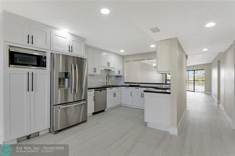 Completely remodeled Queen Model unit in Fairfax, Building F, Kings Point. Kitchen updates include: Quartz Countertops, Under Cabinet Lights with Multi Color Option, Sweep Vacuum System, Extractor Hood, Recessed Lighting & USB Switches. Waterproof Vinyl Plank Floors throughout. Laundry Room with Broom Niche in Unit. Large Screened Balcony off Living Area and Master Bedroom with Tranquil Water Views. Bluetooth Light Fixture and In-Shower Motion Sensor Light in Master Bathroom, Instant-Touch Light Bathroom Mirrors. Amazing Community Amenities include: Clubhouse, Theater of Performing Arts, Fitness Center, Basketball, Tennis, Paddle Boards & Shuffleboard Courts, Recreation Areas; Heated Pool, Sauna, Courtesy Shuttle Bus. Clubhouse Deed Paid in Full.