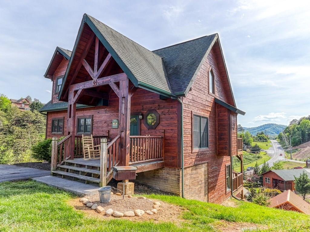 Luxury overnight rental cabin located just minutes from Dollywood and the Pigeon Forge Parkway. Spacious decks for enjoying mountain views!  Three bedroom plus twin beds in loft, cabin sleeps 12 on rental program.