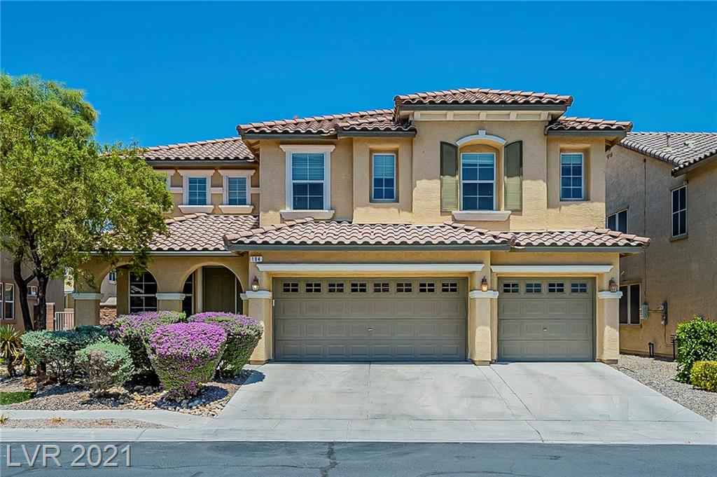 This North Las Vegas two-story home offers a patio, granite countertops, and a three-car garage. This home has been virtually staged to illustrate its potential.