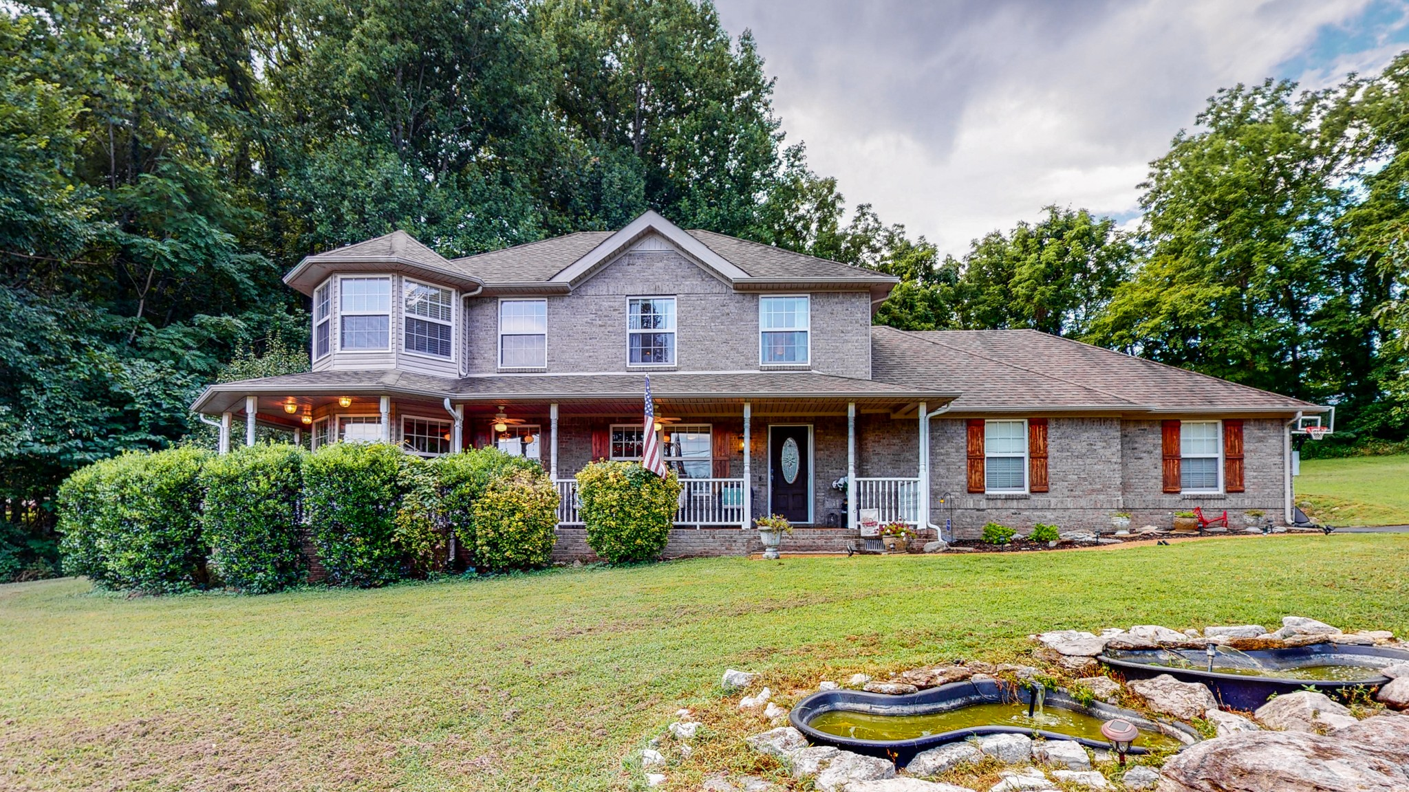 Beautiful 4 Bedroom, 3.5 Bathroom all-brick home sits on 1.32 acres slightly slope lot in Spring Hill's Mathis Valley. Wrap around front porch, mini front yard pond. Surrounded by matured trees, fenced backyard, lots of privacy, fresh paint, hardwood floors, granite counter tops and screened patio.