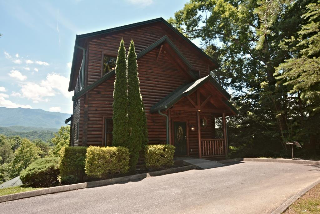 HERE IS A GREAT INCOME PRODUCER! THREE BEDROOM/3 BATH IN THE PRESTIGEOUS GATLINBURG FALLS! AND AMAZING VIEWS! Currently doing fantastic on the rental at Venture Resort and shows to be a 2 bedroom/3 bath but one bedroom is used as another game area with the log bunk beds. Sleeps 12. There is a master on the main and decking with beautiful and amazing mountain views of the Smokies that must be seen to be fully appreciated. Has three deck levels, to enjoy the views and just being in nature. Inside this cabin, you have a large great room, a very large recreation room, a 2nd den/recreation room on the 2nd loft level, & much more. Lots of space, as well as being beautifully appointed with this cabin, both inside & out. Part of a well-managed & established resort community; only mere mins. to many of the attractions of this area, including downtown Gatlinburg and plenty of great restaurants, hiking in the Great Smoky Mountain National Park  & much more. A great, well-located & maintained log cabin - come see it today! The cabin currently does about $60,000 a year on Venture Resorts. SELLER IS INSTALLING NEW CARPET ! He hopes to have it stalled by mid September or before as it rents a lot.