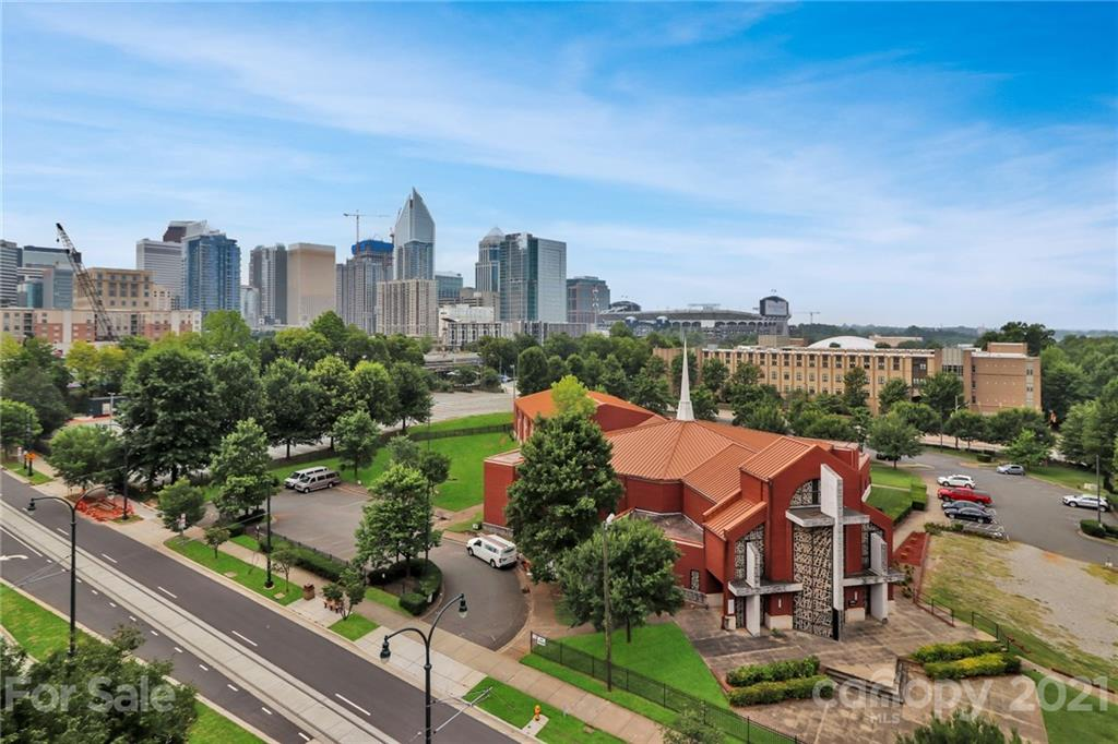 Enjoy spectacular skyline views from your own private balcony! This spacious, 2 BR/2 Bath TOP FLOOR condo is located in popular Gateway Plaza- convenient to nearly everything uptown Charlotte has to offer. Just a few blocks to Panther Stadium, BB&T Ballpark, Music Factory, Blumenthal Arts, Spectrum Center, and Romare Bearden Park, plus there are tons of dining options. AND the new street car line will have stops located in Gateway. Building amenities include secure parking garage, secure building, courtyard swimming pool, and a community/event room (down the hall from this unit) with a kitchen and lounge area , + an amazing rooftop terrace with grill, fire pit, patio. Open Living/Dining/Kitchen area. Gas fireplace. Bedrooms are on opposite ends for privacy. Primary BR has tray ceiling, bath w/dual sink vanity & large WIC. (dryer & range are also stubbed in for gas) Great views from all windows. Live, work and play in the heart of the Queen City!