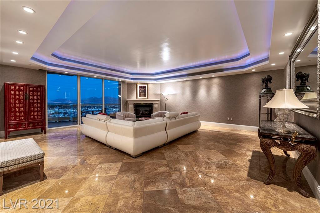 PENTHOUSE - HIGH FLOOR DREAM HOME!!!! 10'HIGH CEILINGS WITH BEAUTIFUL MARBLE FLOORING THROUGHOUT!!! MAGNIFICENT STRIP, DOWNTOWN, MOUNTAIN AND GOLF COURSE VIEWS!!!!! HIGH END FEATURES THROUGHOUT THE PENTHOUSE. SOPHISTICATED LIGHTING, FIREPLACE, UPGRADED APPLIANCES AND CUSTOM CLOSET BUILD OUTS THROUGHOUT.  HUGE VIEW DECKS FOR EXTENDED LIVING AND ENTERTAINING.  A RARE HIGH FLOOR PENTHOUSE 3 BEDROOM WITH 10' CEILINGS!!!! FURNISHINGS NEGOTIABLE. THIS UNIT WILL NOT DISAPPOINT!!!!