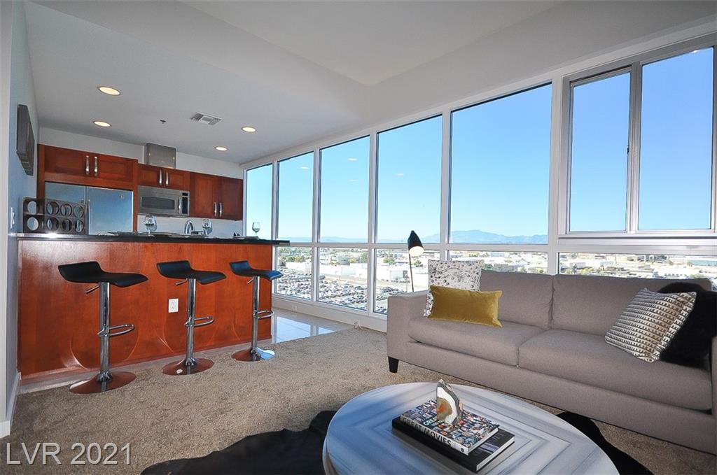 Stunning 1bd, fully furnished residence with city/mtn views. Panorama Towers offers exceptional amenities including a resort style pool & jacuzzi, his/her spa facilities, 5,000sf workout facility, concierge, valet services, conference room, 24-hr guard gated security, and is located just steps from CityCenter, Bellagio and Cosmo.
