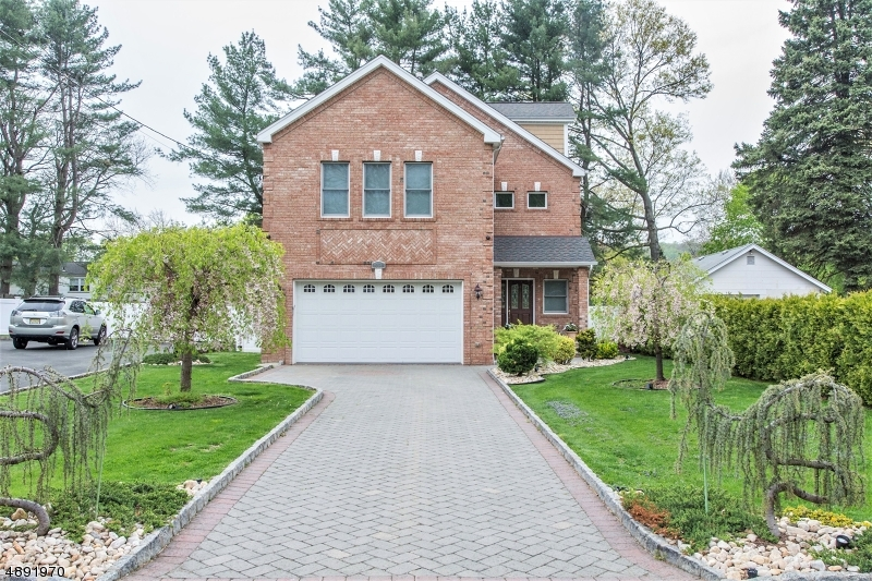 This immaculately,appointed brick-built updated colonial home presents 3 1/2 bath,4 bdrm w/ a custom wine cellar and fam/rec room to entertain in.An arboretum like backyard w/ custom outdoor kitch The upstairs master bedroom has its own private bathroom w/ bidet and a walk-in closet. Second bedroom has a walk in w/ a shelving system. The kitchen is a chef's dream w/ stainless steal GE Monogram Ed. appliances. Custom mill work throughout & recessed lighting. Also, featuring one of a kind arboretum like backyard w/ built in kitchen & a setting to relax & enjoy nights outdoor with this one of a kind built-in  fire-pit. You'll also love the convenience of a great neighborhood near,downtown shops, two miles from 2 different train-lines & a bus to NYC. w/ restaurants minutes away.