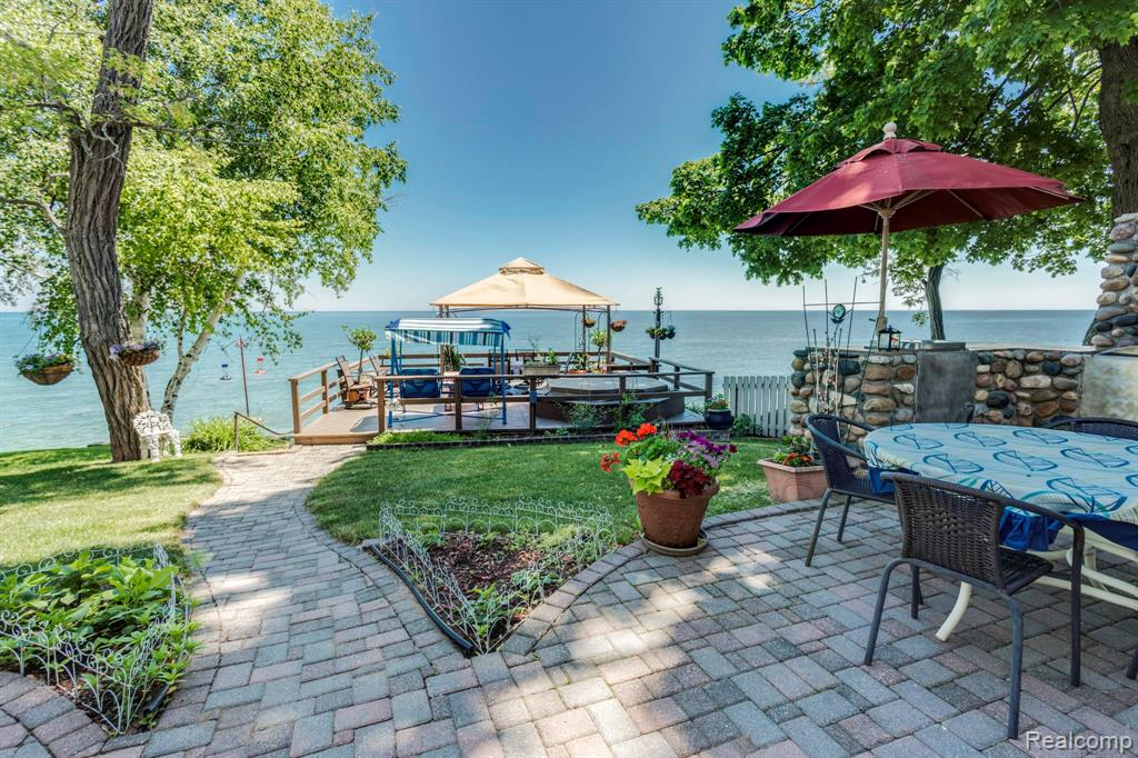 Priced to Sell!!!  You will fall in love with this recently updated  lake house in the Village of Port Sanilac! It truly has it all. Situated on one of the best locations of prestigious Lake Street with stunning views of Lake Huron year round. Built in 2005, this beautiful home has a modern, floor plan while capturing the quaint, charming feel of the town. The house is full of amenities with lots of room to gather for family & guests, including a stunning all-season Florida Room. Plenty of outdoor amenities including an outdoor kitchen and hot tub. Walk down a few steps to your own private beach with room to sun and play in the sand.  There is access to the boat house from the beach with lots of room to store all your lake and beach toys. As a bonus, there is an option of renting out the lower level apartment.  Stroll a short distance to  grab an ice cream, or check out the historical Marina. Port Sanilac is know as a quaint, quiet, and charming Village loaded with tradition.