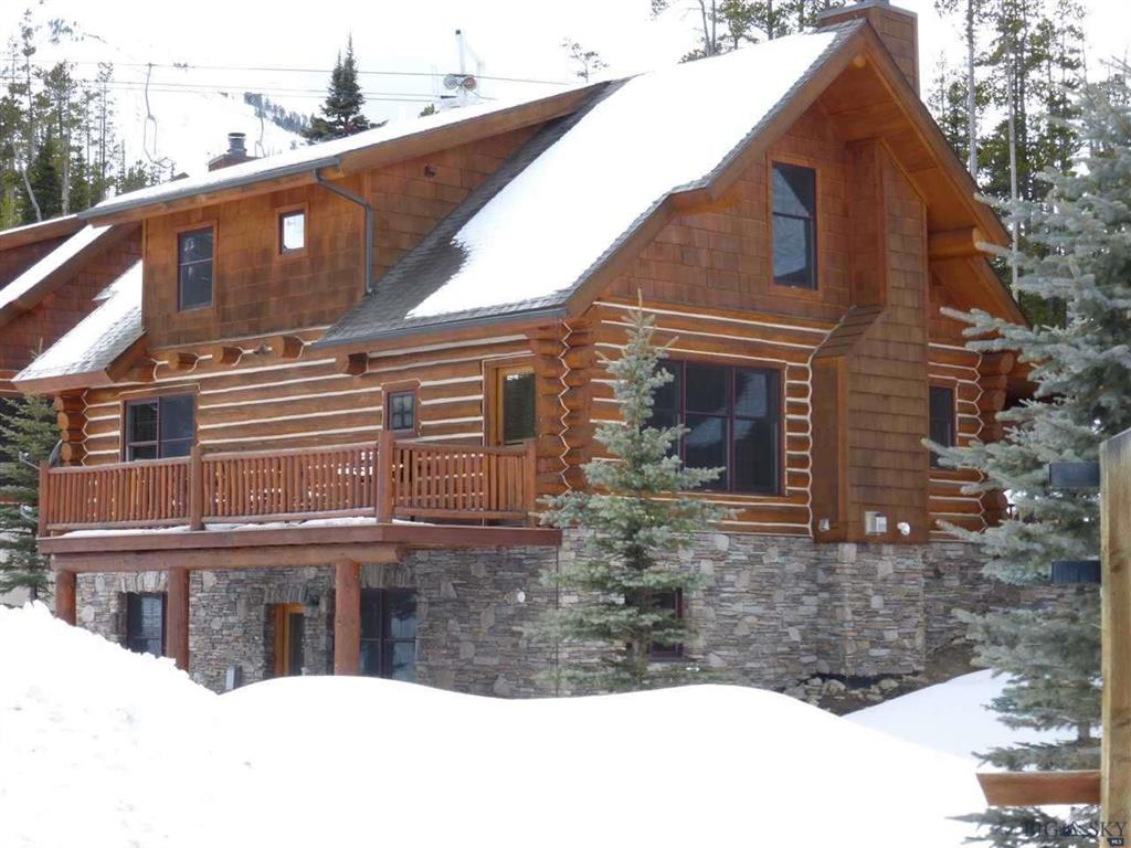"The ""Cabin in the Woods"" is even better with a chairlift nearby.  Put your skiis on and glide right out your front door to the bottom of the White Otter Lift.  Lovely 4BR/3BA, 2567 sf log cabin sold fully furnished and ""turn-key""."