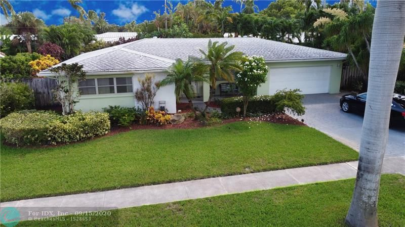 This gorgeous 3 bedroom/2 bath home features an oasis-style backyard with pool, lush foliage, landscape lighting, outdoor shower, and fenced for privacy.  It features tons of natural light, open floor plan, nice-sized kitchen open to dining, a Florida Room, and large laundry with storage, two-car garage, and attic storage.  The master has private seating area with access to backyard, master bath with dual sinks and large tub/shower combo, and spacious walk-in closet.  Tons of natural light floods the home from all sides, and has currently been converted to a two bedroom, but easily converted back to a three.  Property is located on a tree-lined street in the A-rated Floranada School District.  Close to shopping, restaurants, and just over 1.5 miles to Lauderdale-By-The-Sea Beach.
