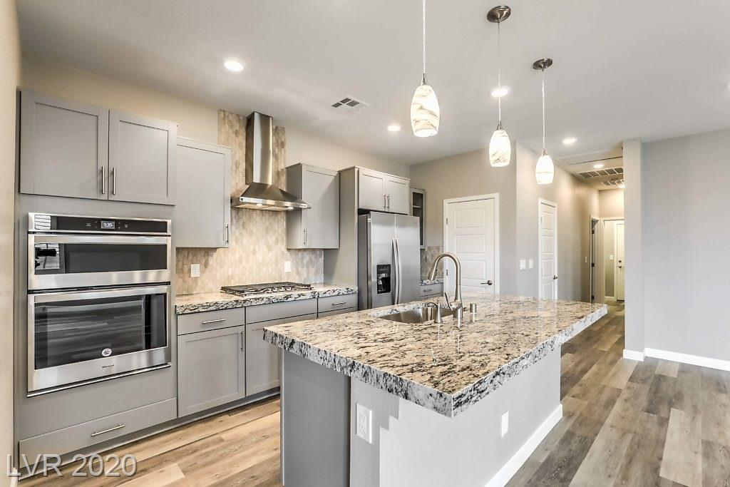Brand new never-lived-in contemporary single story gem. Energy efficient modern & highly upgraded w/2-tone paint, wood-like flooring & shutters throughout. Designer kitchen w/thick granite slab, custom cabs, Whirlpool SS appl package, farm sink, hood, backsplash & pantry. Roomy master w/2 closets (1w.i.). 2nd BR's w/w.i. closets, sep laundry room, x-storage, surround wired & French doors to backyard w/patio, cover, BBQ stub on a quiet cul-de-sac.