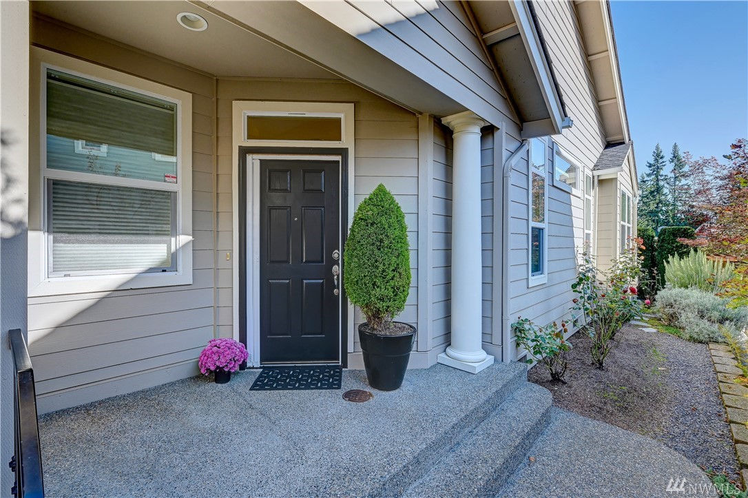 This exceptionally light & bright Chelan plan has an open concept living area w/an abundance of windows and tall ceilings that contribute to a spacious feeling. Upgraded finishes including granite counters and main area hardwoods. Large master en-suite with dual sinks and a walk in closet. True second bedroom adjacent to a full bath. All apps incld. Sunny & peaceful yard with a newer Trex deck, plenty of gardening space and nice pet area! 2 car garage & rare, private driveway for a Chelan home.