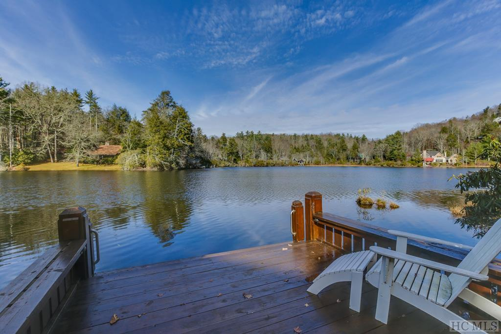 Looking for something special?  This is it!  Amazing views of Lake Ravenel can be enjoyed both inside and out.  This sophisticated and comfortable home is rare to find on a flat lot in the mountains.