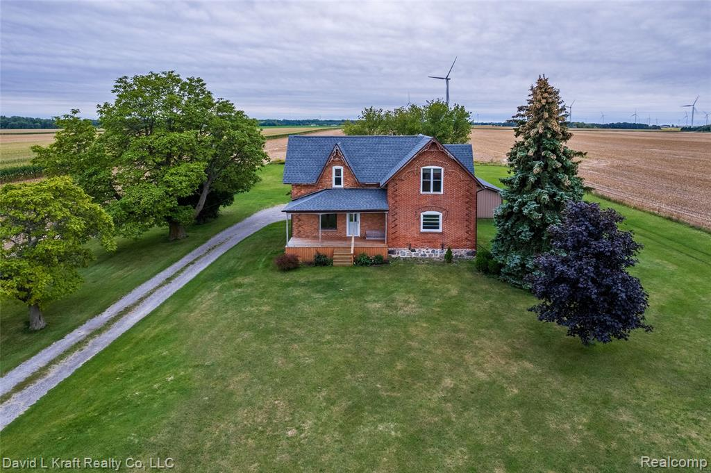 """COUNTRY HOME ON 1.9 ACRES: Here is a lovely  3 bedroom, 2 story, brick and frame home originally constructed early 1900's with additions in 1965 and 1993. Covered front porch 7'-6"""" x 20'-6"""" and concrete rear porch 6' x 20'-6"""". Large dining room with fireplace overlooking the back yard. One bedroom on the main floor. Large remodeled main floor bathroom and convenient main floor laundry. Upstairs features a bonus room, 2 bedrooms and a full bathroom. 3/4 basement with unfinished gas log fireplace. 24' x 40' attached garage.  There is an 18-'6"""" x 26'-6"""" red barn near the rear of the property. Great location surrounded by farmland but not too far from Caseville. Make an appointment to view this home today!"""