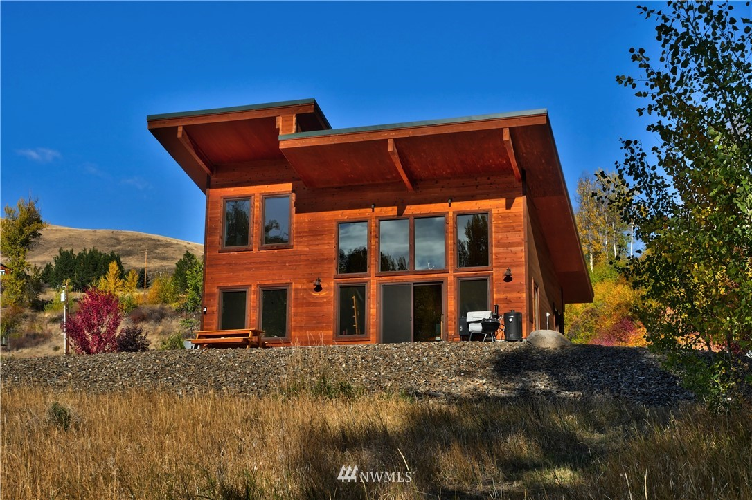 A dream come true—your own private riverfront retreat. Over 23 acres w/more than 1300 feet of private Twisp River frontage. Contemporary style cabin featuring a Finnish wood-fired sauna. Enjoy the sauna, then cool off in the river. Main floor w/720 sq. ft. and one bedroom, plus a loft w/240 sq. ft. Washer/dryer hookups in the loft. Extra large tiled shower in the ¾ bath. Big windows w/private river views and southern exposure. Low maintenance landscaping around house. Extensive wooded area near the river—create your own trail system. Property extends across the road, and adjoins Forest Service land for added privacy.