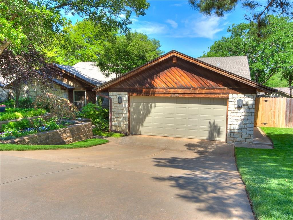 Welcome to 2101 Bent Twig Road. Underneath your new roof and gutters is a brilliant floor plan highlighted by a tremendous amount of natural light. Luxurious wood flooring and modern tile. Updated guest bath guaranteed to impress. Large master bed with dual walk-in closets opens to lovely master bath – tub tucked into relaxing nook next to vanity and renovated shower. Spacious living room with regal stone fireplace and vaulted ceiling adjoins main dining area and granite-top wet bar. Additional dining space available in kitchen along with so. much. storage. With sliding glass doors, massive windows, and hail-resistant skylights, you are only going to find more natural light outside. Multi-level deck with covered patio. Expertly-engineered landscaping with rich fescue, massive boulders, and flagstone with a lighting system to illuminate your front & back yard oasis. This is an entertainer's dream. With so much to offer at an unbeatable price, this gorgeous home won't last long.