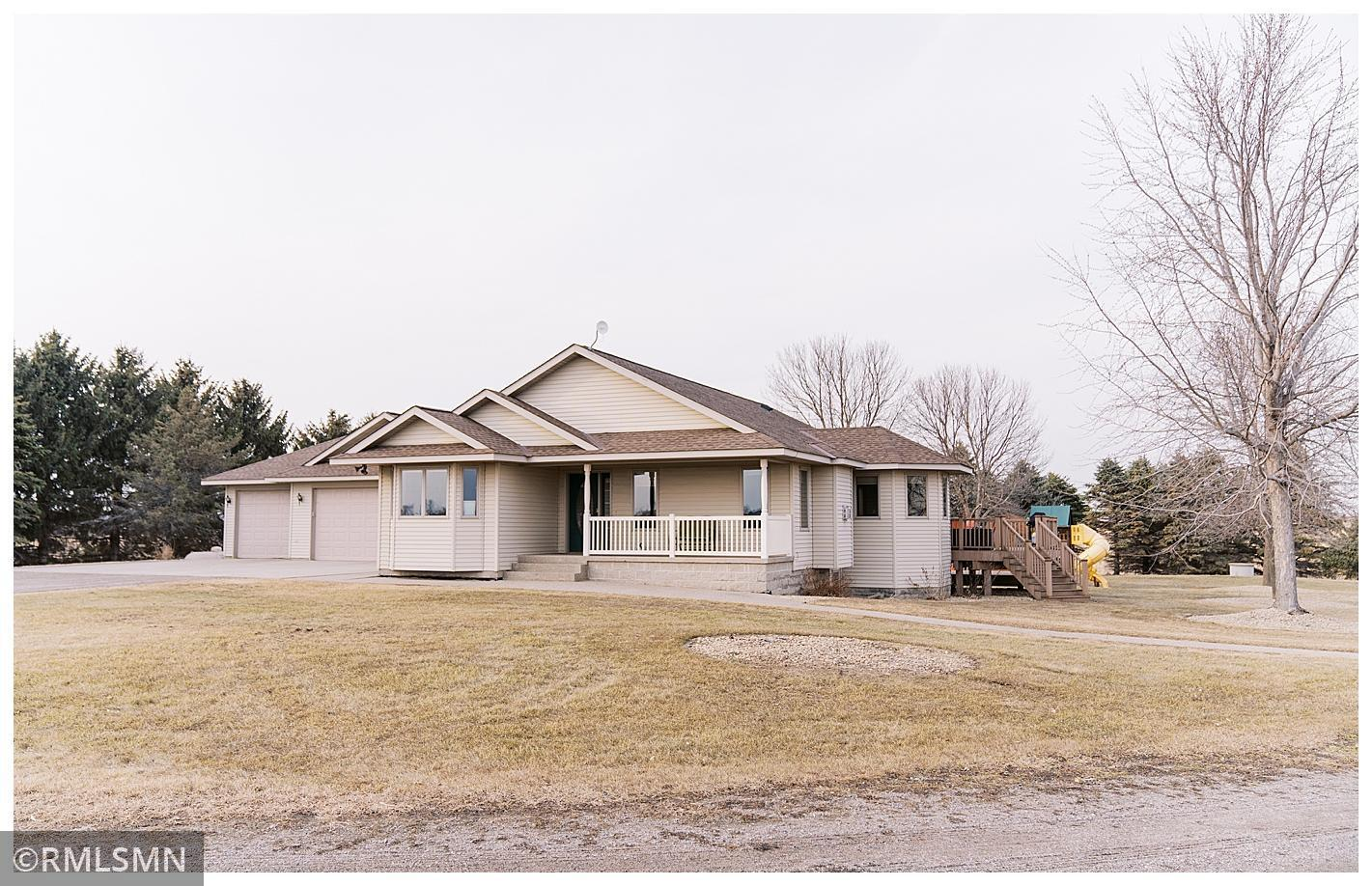 If you are looking for an Absolute Stunning Rambler in a great location on 5 acres, with a Large Outbuilding Look no further. This Beautful home features a Nice Open Large kitchen with a huge center island, corner pantry and a beautiful view out the patio door that leads to the deck and patio. The living room upstairs has a beautiful stone gas fireplace. There are 3 bedrooms and 2 bathrooms on the main level which includes a master suite. The Master includes a private bathroom and a huge walk in closet. The entryway/mudroom entering from the garage has washer and dryer and nice storage and closets. The yard is nice and level and a 28x38 heated shed in the backyard. The outbuilding has in floor heat roughed in for future and a bathroom. This home has ceramic tile, wood floors and has a great layout. You will love the feel you get when you enter this home. There is a great sized yard to enjoy the outdoors. The lower level is finished and has 2 more bedrooms and bath, family room w/bar