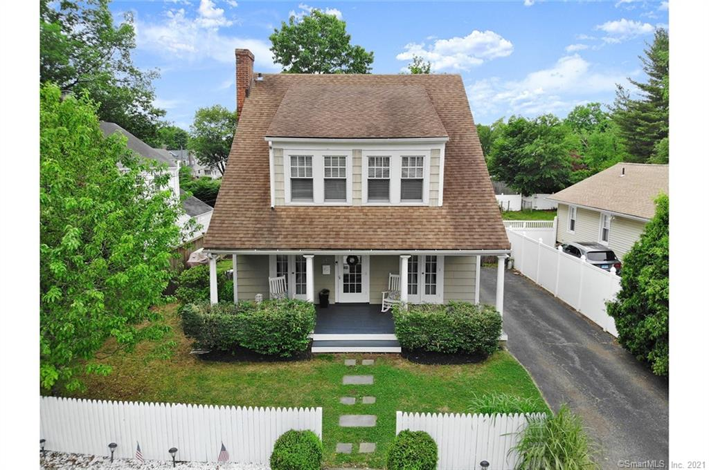 Convenience,Charm,Character! Picturesque Colonial combines the charm of yesteryear w/modern updates. Beautiful curb appeal, showcasing a wide-planked freshly painted porch, graceful archway door entrance, surrounded by lush landscaping, & white picket fence. Spacious Living rm w/cozy fireplace, french doors, dining room w/french doors, wainscotting, both rooms have beautiful hardwood floors. Kitchen has white cabinetry, SS appliances, tile backsplash, countertops are granite & butcherblock. A half bathroom & spacious mudroom leading to the patio complete the first floor. Upstairs offers a Main bedroom w/walk-in closet, hardwood floors. Two additional bedrooms are spacious, light, & bright w/hardwood floors. Upstairs full bath w/mosaic tile floors. Laundry is conveniently located is on the second floor. Finished walk-up attic, on the third floor, creates additional space & not included in the home's square footage. Backyard is level w/blooming gardens, landscaping, surround a bluestone patio w/custom-made bar, & a shed for storage. Recent improvements: Converted to Natural Gas, New furnace, New hot water tank, Electric amps increased to 200amps, Conversion switch for generator. Within walking distance to Fairfield's charming downtown, restaurants, amenities, train station, beaches. Award-winning Riverfield school district.