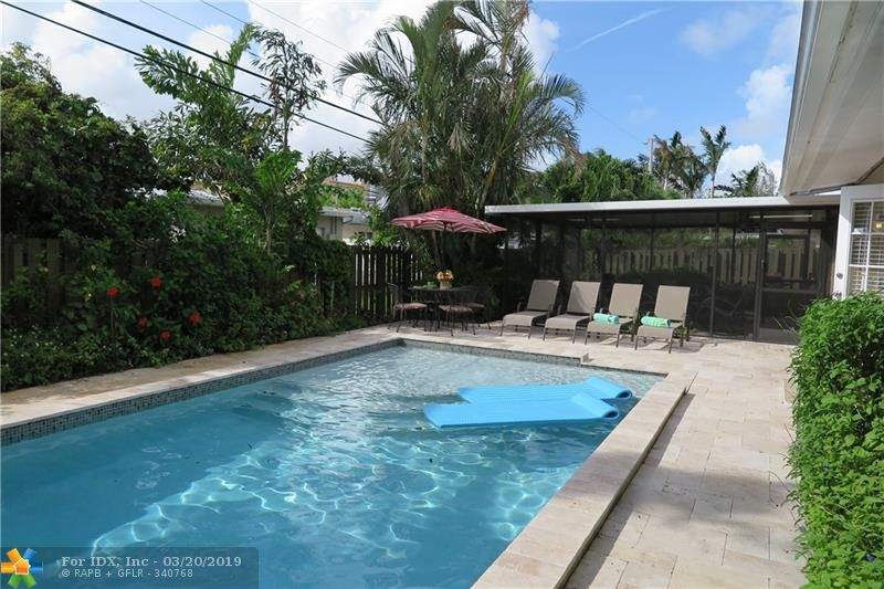 Wonderful outdoor living under large screened patio room overlooking your modern rectangular, new heated salt pool (2016) with sun shelf.  This 3 bedroom, 2 bath house is in the Central area of Wilton Manors in a sweet neighborhood north of the Starbucks and Rosie's.  Currently operating as a licensed vacation rental.  Furnishings are negotiable.  Open Kitchen / Living Room / Family Room-- nice flow.  One car garage and laundry room.  Tropical landscaping -- yep, it feels like you are on vacation!  Thinking of retiring here in a few years.... this could be your answer.  Rent it out until you are ready to make your move!