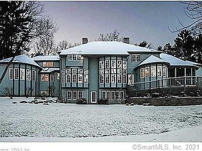 """Welcome home to your own private retreat! This majestic, custom-built waterfront property offers peaceful views of Whitman Pond from nearly every room. The dramatic 2-story foyer with interior balcony leads you to a light-filled family room with pond views, cozy fireplace, wet bar, and built-ins. The bright eat-in kitchen provides ample space for preparing gourmet meals. The enclosed screened porch is a peaceful place to watch the deer, or listen to the birds and bullfrogs sing. The formal Dining Room with gas fireplace is the perfect place to enjoy special celebrations.  The elegant formal living room with its inviting fireplace and lovely wall of windows brings the outdoors in: a perfect place to entertain or read a book! The first floor MBR Suite has a gas fireplace; a pampering bath with an oversized tile shower, a whirlpool tub, 2 separate sinks and dressing areas; a sitting area overlooking the backyard and pond; 2 walk-in closets; a breakfast bar; and an adjoining home office or library! Upstairs you will find 4 more bedrooms, 2 """"jack-and-jill"""" full baths with separate sink/dressing areas, and walk-in closets.  One of the bedrooms has a fireplace; one has a large bow window with a built-in window seat. The finished walkout Lower Level has a huge Rec Room with fireplace and wet-bar, a full bath; a home gym, and plenty of storage space!!! 3 Car attached garage; hardwood floors, a large deck, and a stone patio with fire pit and gas grill complete the fabulous amenities!"""