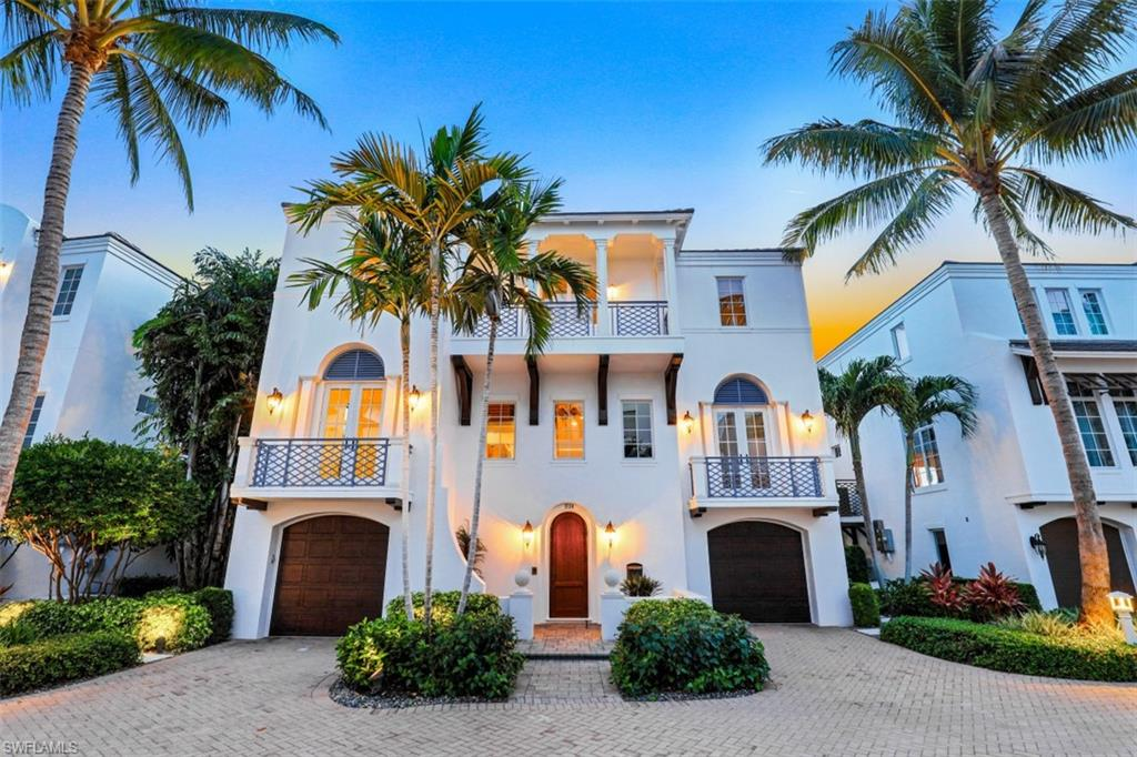 H2320 Intimate small community of 12 single family homes across from Casamore's private gated beach access-11B impresses with well over 4,100 air conditioned sq ft of bright Western sunset view exposures and bonus partial Gulf views from multiple large impact picturesque windows, w/automated window shades, and tall sliding glass doors! Open-air floorplan offers 3 1/2 floors with a 3 stop elevator and 4th level towering observation terrace to delight in scenic, romantic white sand beach views with sizzling sunsets, fireworks and private paradise basking. Volume ceilings, wet bar, wide plank oak wood flooring in main living areas, 4 car garage, open gas cooking kitchen w/striking Viking appliances, breakfast bar and large scenic dining area! Living area lanai with mood setting gas fireplace and large bedrooms include outdoor balconies. Dual master bathroom suites sport bright mesmerizing views plus large closets w/lovely, functional custom cabinets. Western facing private pool w/spa, fountains, Aqualink system and covered dining/gathering area all in addition to your 40' boat dock! Stay healthy and happy savoring your SW Florida/Naples lifestyle!