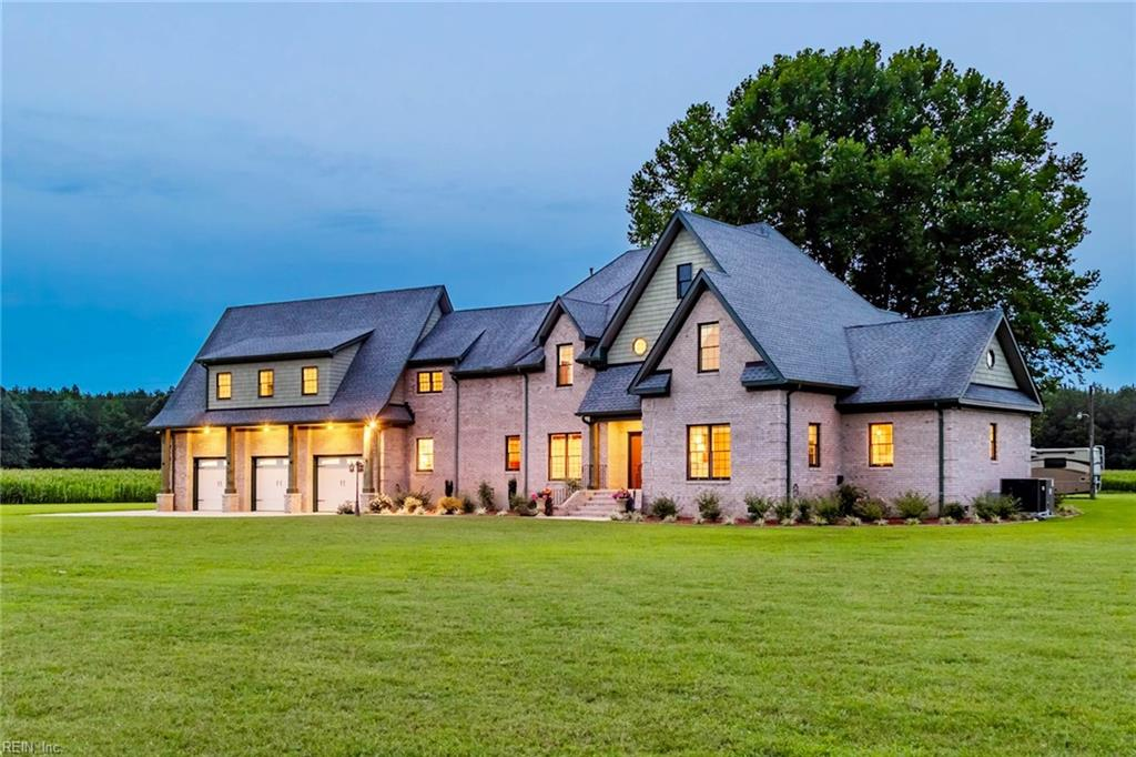 Exceptional quality custom built brick home on nearly 200 acres of prime land for privacy and outdoor recreation. Experience luxury living away from it all, yet still within easy driving distance to all major commercial centers. Owning both sides of the road means no visible neighbors; just abundant wildlife, the tranquility of country living; rented farmland and lush woods for hunting, trail riding and other outdoor activities. Also, great income opportunity from logging some of the Cypress and Pine. The custom built brick home features 4 bedrooms in the main part of the house, with a 1st floor master suite and an additional 'mother-in-law' suite designed to be a separate 2 bedroom apartment with separate entrance and garage. The 3 car attached garage has a 9,000lb lift and the detached oversized 1 car garage / workshop has power and water. The custom kitchen features soft close cabinets, center island with sink and stainless steel appliances. A complete features list will be provided