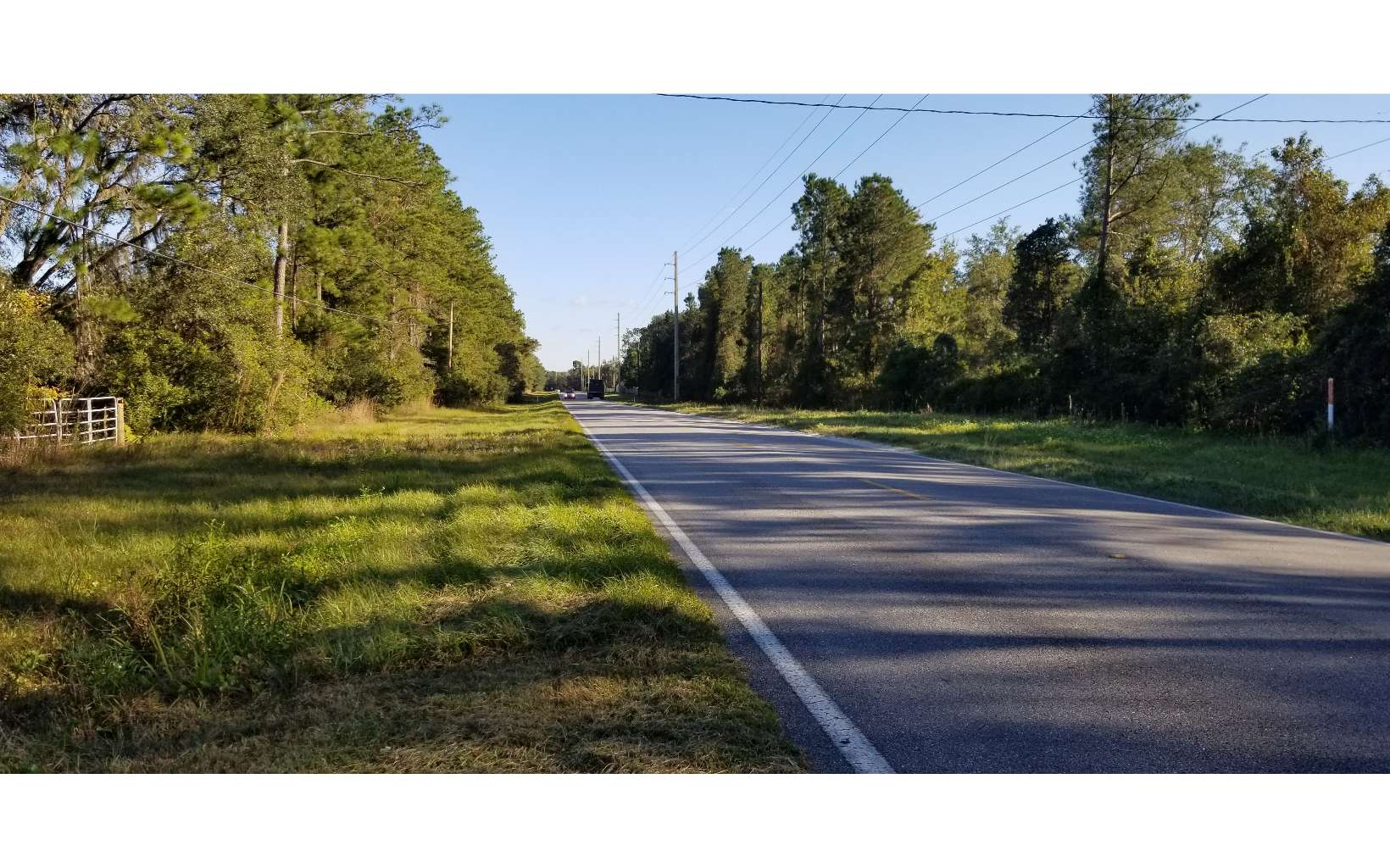 Rare opportunity to own 292.5 acres just outside the city limits of Lake City that backs up to Columbia County's new proposed flat field recreational complex. This is a desirable and growing area of the county with new development ongoing at Woodborough North next door. Extensive frontage on NW Lake Jeffery Road and 50' access parcel off NW Moore Road. Upland areas planted in pine plantation in 2020 and wetlands areas are natural cypress and hardwoods. A 50'x100' heavy wood frame metal enclosed barn is located on the property with 200-amp service, well, septic, security, and internet. A bald eagle nest is located in one of the cypress heads on the property along with plenty of deer and turkey. Listing includes Parcel ID's 23-3S-16-02271-003, 23-3S-16-02271-002, 24-3S-16-02275-001, 14-3S-16-02124-000, 13-3S-16-02112-000. Owner will consider dividing the property. Zoning is 131.5 acres of RSF-2 (1 dwelling per 20,000 sf) and 161 acres of RR (1 dwelling per acre). Potential of up to 447 units with a PUD. Property is located on the north side of NW Lake Jeffery Road so well and septic is permitted on smaller acreage lots.
