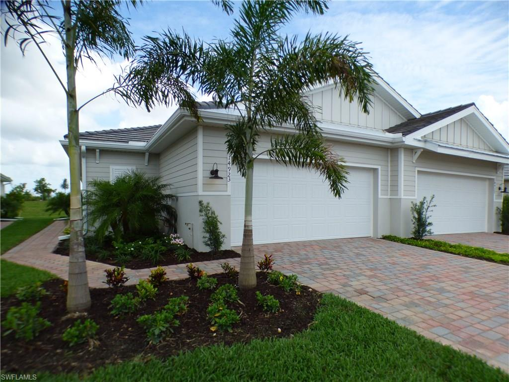 Gorgeous Brand New Villa in Naples Reserve! This modernly-designed twin villa home features an open-concept design that feels like a single-family home. Walk-in the front door and you will instantly notice the well-appointed kitchen features a large island perfect for bar-style eating, a pantry, and plenty of counter space.  A den with double doors allows the Florida sunshine to beam into the kitchen.  The dining area is ideally situated between the kitchen and living room, making entertaining family and friends a breeze. Off of the living room is a covered lanai that extends the living space outdoors and provides the perfect place for relaxing or dining al fresco. An expansive owner's suite, situated at the back of the home for privacy, includes two walk-in closets and an en suite bathroom with double vanity. The guest bedroom features a walk-in closet and is in close proximity to the second bathroom.  A two-car garage and laundry room complete this home. Naples Reserve, designed for those seeking a fun-filled and casual Florida lifestyle. Call or stop by today for your private tour, you will not be disappointed!