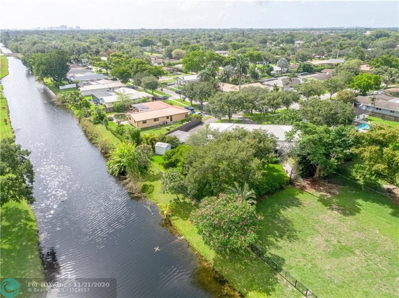 Over 3800 SF in this stately 5BR/3BA canal front home. If it is space you desire look no further! Public rooms include; Family room, Florida room, Living and Dining rooms, an Eat-In Kitchen plus a Craft room and a huge screened porch. An oversized 2-car garage has laundry plus additional storage. A 2-bay free standing carport perfect for your boat. 4 of the 5 bedrooms are situated off two opposing wings of the home offering privacy from the Master and guest rooms. Bedrooms five is currently used as a music room which is positioned off the formal foyer. A chef's kitchen has pass-throughs to both the Family and Florida rooms and offers 2 pantry closets. A spacious island for additional seating. Impact windows, a circular drive and oversized landscaped yard complete this home's desirability.