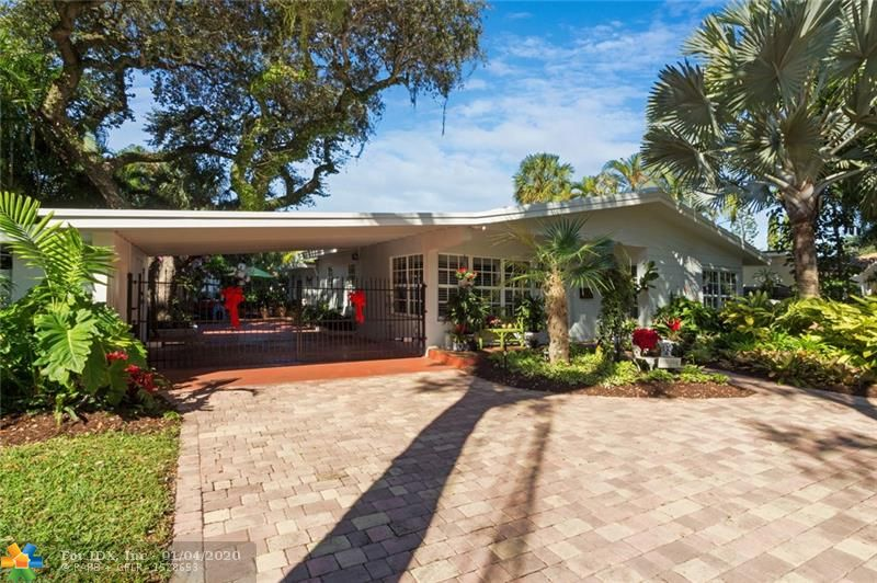 """This is it! Quintessential Florida Living at its Best! Located in the heart of Wilton Manors, yet set on a Huge secluded fenced & gated River front lot surrounded by amazing tropical landscape under a canopy of Majestic Oaks. This 3 bedroom 3 bath fully renovated home has it all! Heated pool & hot tub, large river front dock, full house generator w/buried LP tank, Impact glass doors & windows,  fireplace, New concrete tile roof, electric gate, 2 storage sheds, lots of parking with paver circular drive & 2 car carport. Outside is a tropical oasis of lush landscape w/orchids everywhere! Inside is updated, comfortable & inviting. Large bedrooms and bathrooms, extra closets, wood and tile floors, marble & white kitchen. A true Must see. Call today for your private tour of the """"River House"""""""