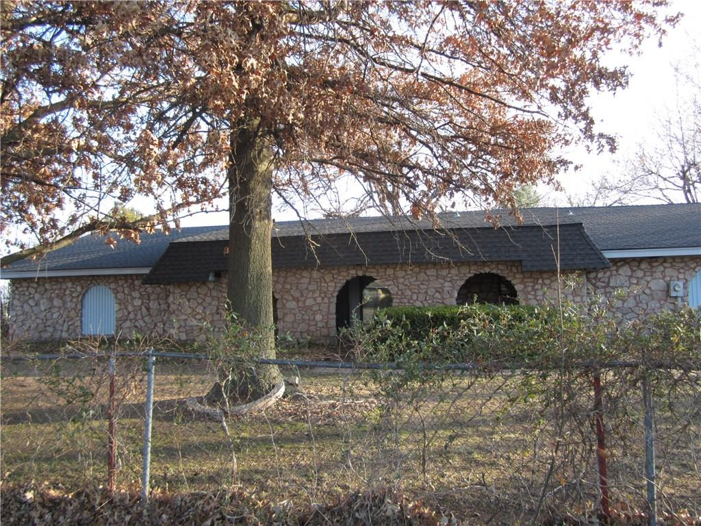 Green Valley Rural Water is El Reno. Electric is OG&E. The Well for Yard does not work and NO WARRANTIES for it or REPAIR. SEPTIC SYS IS EAST SIDE HOUSE BETWEEN FENCE N HOUSE with 6 Latteral Lines. SHOP has Electric, concrete floor, tall ceiling, SHOP 30x50 and water available, Over head Gar door Opener to shop DOES NOT WORK NO WARRANTIES OR REPAIR and there is 1 single entry door. Cellar LEAKS NO WARRANTIES OR REPAIRS. Opener to the house garage does work, 2 car over sized has work area work bench. Hot Water tank  50 gals.  A/C Unit installed 2013. X-Lg Master 2 closets (1 is walk-in). 2 entry closets, Living room very large can be optional formal dining/Living with front window view. Long Covered porch has curved rock arches. Property is chain link fenced, dbl gate to bk yd and shop area. 1.44 Acres MOL, plenty room for play, garden or family pet.  White cabinet in utility rm to the Left and ALL yd and decorative items are RESERVED. Buyer to verify All Schools and sq ft for Home.
