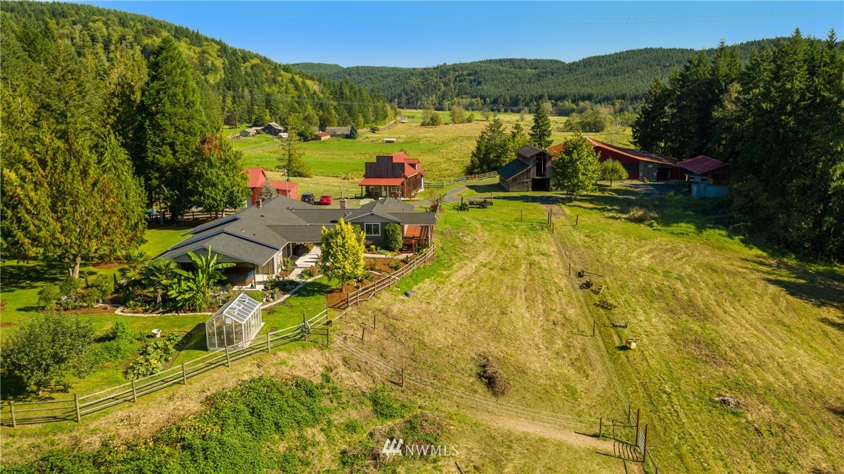 """Country Dream Property - 2600+sq ft one-story home, shop, barn, guest house, stables, machine shed on just shy 20 acres of gorgeous! Updated home features 3 bdrms, 2 baths + studio/flex space with 2nd kitchen - master suite features awesome year-round outdoor space.28x56 2-bay Shop. 36x48 Cedar Barn.Stable-19 stalls, 60x120 indoor arena w/viewing room.Massive Machine Shed.Awesome """"Old-Time"""" bldg for guest/business/? Paddocks,Green House,Timber,Creek,Pasture.5 miles from I-5, 4 miles from town."""