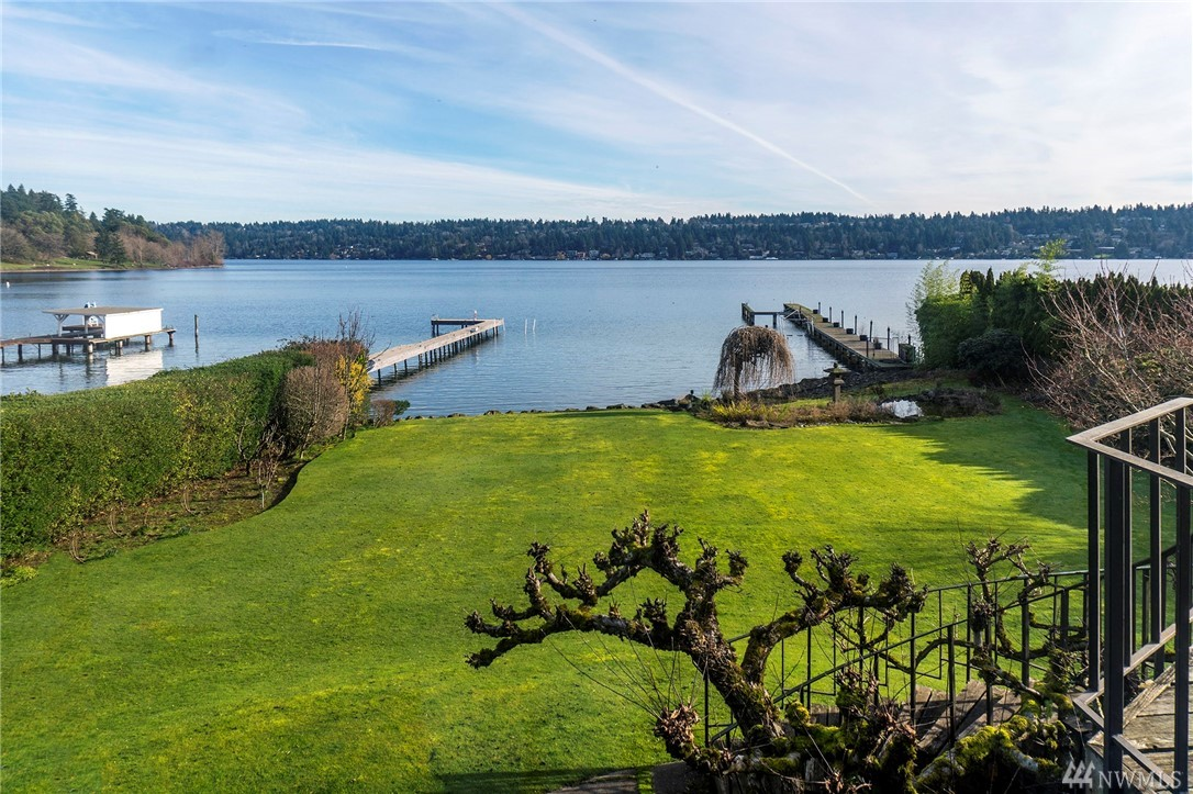 Opportunity knocks! Love it or level this mid-century diamond in the rough set on a full 100 feet of prime Seward Park Gold Coast waterfront. It's mostly level street to water lot provides over 3/4-acre of privacy, a huge lakeside lawn, dock, & stunning views. SF-9600 zoning also means there is potential for subdividing (Buyer to verify). Ideally located on a quiet street, just a stroll away from Seward Park & Martha Washington park with easy access to all Seattle has to offer.