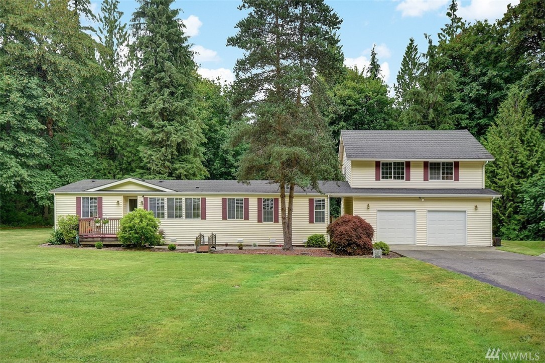 """Where to begin?!1848sqft main home meticulously maintained & features 3beds/2bath, vaulted ceilings, built in hutch & great room. Soak in hot tub while deer meander thru the yard. 1024sqft detached garage has 896sqft of storage above that could be finished off for a huge bonus room. Add shower & kitchen to the """"office"""" & you've got an adorable 720sqft guest cottage. Want a shop? Got one of those too w/a whopping 1920sqft! RV carport included! That's 6428sqft of usable space for you & your toys!"""