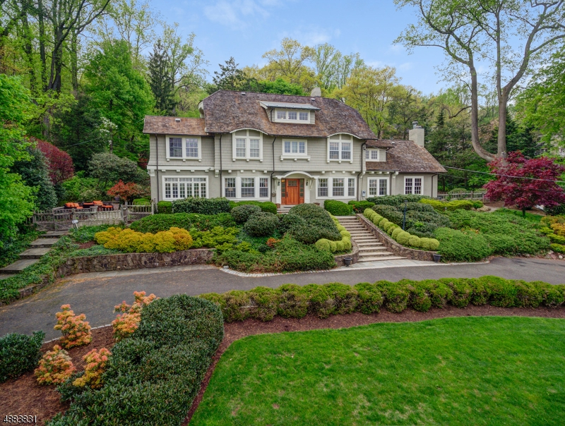 Resting on ~One Acre of Gorgeous Property, 'John James' Designed/Renovated 1909 Custom Colonial, is Certain to Turn Heads.The Paved, Circular Driveway Pauses at the Impressive Stone Front Steps and Walkway. Attention to detail produces Pure Perfection! Step inside and you are treated to a collection of light, texture & color as polished hardwood floors flow into the adjoining rooms, revealing enormous Living Room, Inglenook Style Fireplace, Sitting Rm + French Doors Opening to Side Patio. Across the Foyer, Banquet Size DR w WBFP is great for entertaining. The Family Room w Vaulted Cross-Beam Ceiling + Floor-to-Ceiling Stone Fireplace is the Center of Activity. Mud Room. Renovated Kitchen. CAC. 4 floors of Living Space All Ideally positioned on the property- NYC Skyline Views enhance the experience. *W*O*W*!