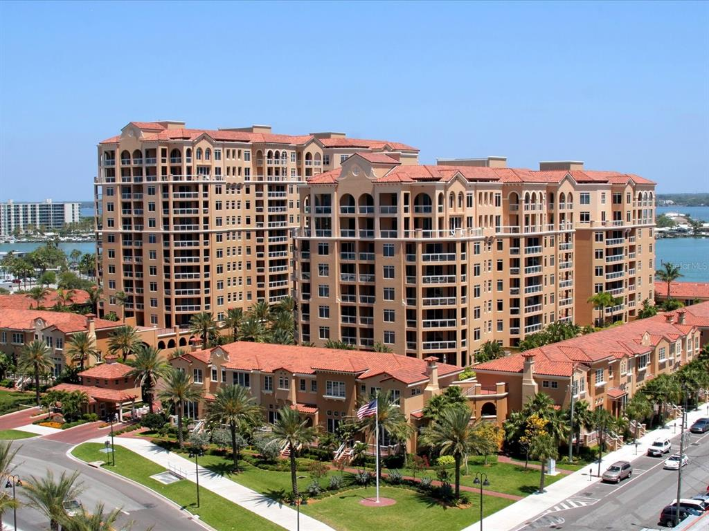 The story is a little different for each of these condos, don't you think? Each condo home possesses its own set of virtues, I find. I'll start with the setting of 401..Imagine an exquisite Mediterranean compound situated on Clearwaters Harbor, across the street from the beach, walking distance to all that the North Clearwater Beach Corridor offers. For example, envision 12 eateries, from casual to fine dining within a blocks walk. Now, let's talk floor plan, shall we? The strength of this, the Avalon floor plan is the FULL 3 BEDROOM LAY-OUT, which essentially offers two en-suites, and a 3rd bedroom graciously proportioned, and magnificently perched on the southwest corner of the Mirasol Tower allowing an ease of luxuriant living space seldom encountered. I know you're curious about the exposures, aren't you? Embrace the nurturing winter sun on your terrace which is accessible from the kitchen, breakfast area, living room and primary bedroom, which also offers a Gulf view from a separate balcony. Nuanced lushly landscaped courtyard vistas are well evident from two more bedrooms. The appointments, well that's where 401 distinguishes itself...A profound, and inherent sense of house and home permeates the warm interiors that truly lend for a remarkable living environ. Masterful paint treatments, custom wood cabinetry, stone counters, superior appliances,tile and luxury plank flooring, upgraded primary bath shower, wood vanities are, but a few of the many attributes of this beach sanctuary. 6.5 acres of 24 hr guard gated amenities await within this amenity laden icon we know as Belle Harbor. We await your visit..