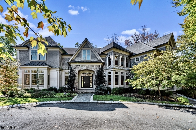 Welcome home to tasteful elegance in this 8,098 sqf 7BD/6.5BA retreat on .62 acres. This mansion lets you work, live and play in pure luxury. The chef's kitchen offers S.S. Sub-zero, Wolf and Miele high-end appliances. Features 1st floor office and in-law suite with WIC. Huge master en-suite has tray ceilings, seating area with gas fireplace, oversized WIC, double showers, marble tile, and a jet soak tub. Oversized closets and large windows in all bedrooms. The gorgeous lower level features recreation space, including a bedroom suite with full bath & WIC, an elevated mud room which leads to the 3 car garage. Backyard includes stunning outdoor pool, spa, and patio. Mid-town direct train line, high-ranking Short Hills school pyramid, shopping, hiking and golf. Book your private viewing today!