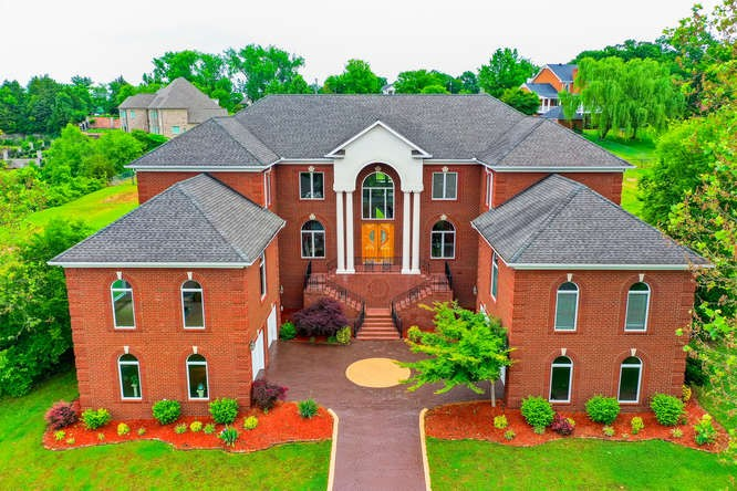 LIVE IN LUXURY in this Lakefront custom-built home that's perfect for family & entertaining.  Walk to your private boat slip in the community dock. Enjoy spectacular views of Old Hickory Lake. Gated Community. Grand foyer w/marble floor & gorgeous floating staircase. Chef's kit w/Thermador cooktop & Sub-Zero frig/freezer. Master w/sitting area & FP.  Mstr bath has sauna shower & jetted tub.  6 beds, 5 w/private baths & jetted tubs. Lounge upstairs with amazing lake views. 4-Car Garage.