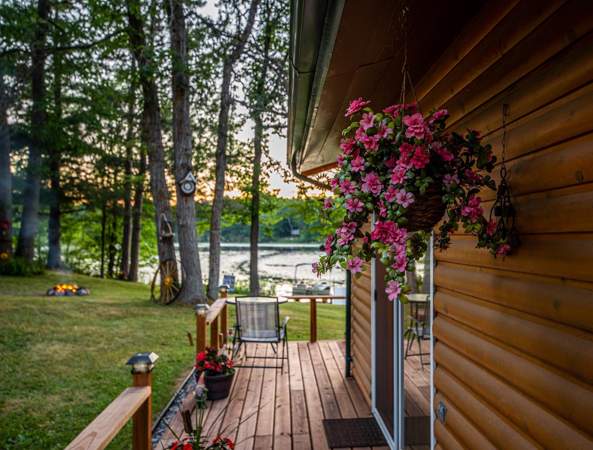 Turnkey, easy care cabin with 200 feet of lakeshore. A terrific spot for those looking to experience the recreation Northern Minnesota is known for without breaking the budget. The home comes with just about everything you need to start enjoying lazy days at the lake, including furnishings, appliances, dock and even a 16 foot pontoon with trailer. Renovations in the last few years include a new septic, roof, 22x25 garage wired for 220V, decks, drain tile and plumbing. There is also an 18x20 carport for storing toys or the pontoon. If you have to check in with the outside world, fiber optic internet is available for hook up. Quiet, tranquil setting with panfish, bass, northern and the occasional walleye being favorite catches.   Imagine sitting on the log swing and relaxing while letting life's chaos fade away. View the drone video & come take a look.