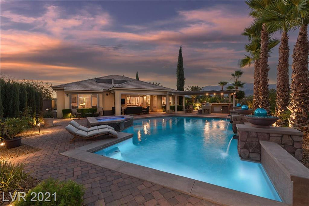 Only the finest finishings are offered in this one-of-a-kind retreat located in the guard-gated Palms Community of Silverstone.  Welcome home to a lush oasis in the desert!  The third of an acre, pie-shaped lot offers virtually no neighbors, manicured gardens, a resort-style pool and spa, elegant pavers, dramatic fire features, plant containers and an outdoor kitchen/bbq.  Enjoy majestic mountain views from the raised patio or relaxing in the spa.  The outdoor living space of this home is truly one of the most magnificent in the valley.  However, the upgrades are not limited to just the exterior.  Recently remodeled, the gourmet kitchen boasts high-end custom cabinetry, a spacious island, beverage center, walk in pantry &  quality stainless appliances.  The owner's retreat offers a spacious bath and custom closet.   Gated courtyard entry. Crown Mouldings throughout home.  Select furnishings may be available by separate bill of sale. DON'T MISS THE VIRTUAL TOUR VIDEO WALK THROUGH