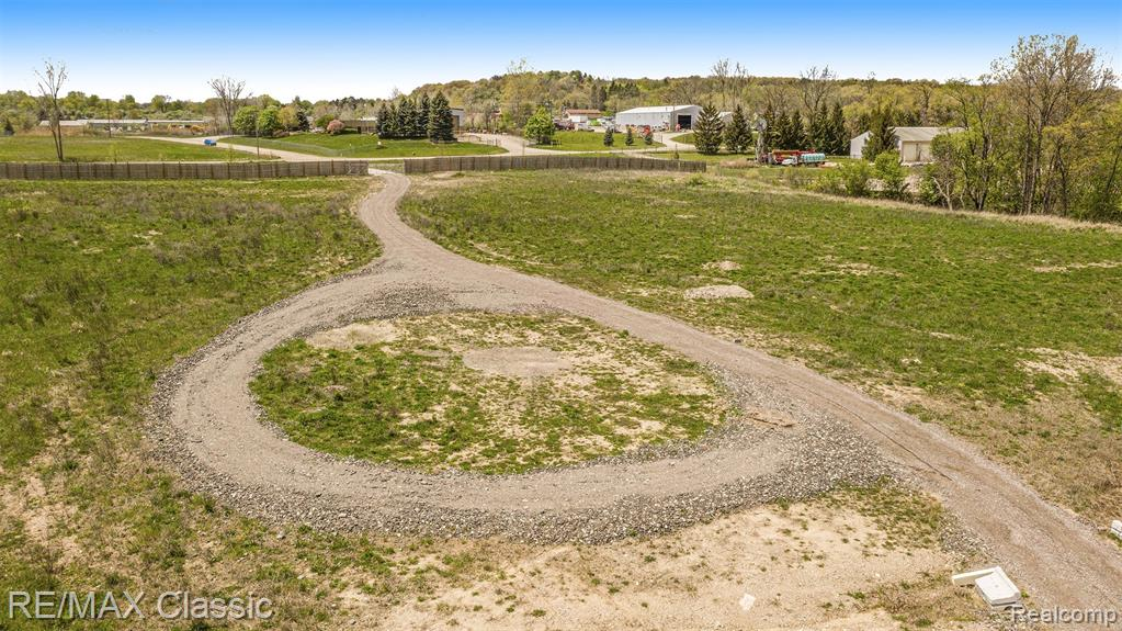 10 acres of prime industrial property located in Milford Twp with easy access to I96. 500 feet of frontage on Childs Lake Road. The site is leveled and ready to go. New fencing, rolling gate, and gravel driveway. Outside storage is allowed. Possible splits. The seller will consider a land contract with 20% down.