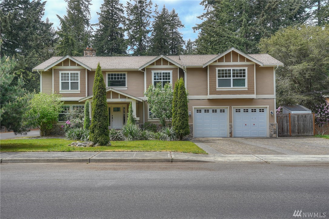 Light & bright home located on a quiet street near Lake Steilacoom! With a little imagination & TLC this 3,785sf blank canvas of a home will be better than new! Features include hardwood floors, kitchen w/ss appliances & granite counters, large den/office on main, 5 beds & utility upstairs including master w/bath & walk-in. Lower level w/rec room, 1 addt'l bedroom & 3/4 bath– MIL or rental income potential w/separate entrance to the fully fenced 10,115sf backyard! Even A/C. Opportunity awaits!