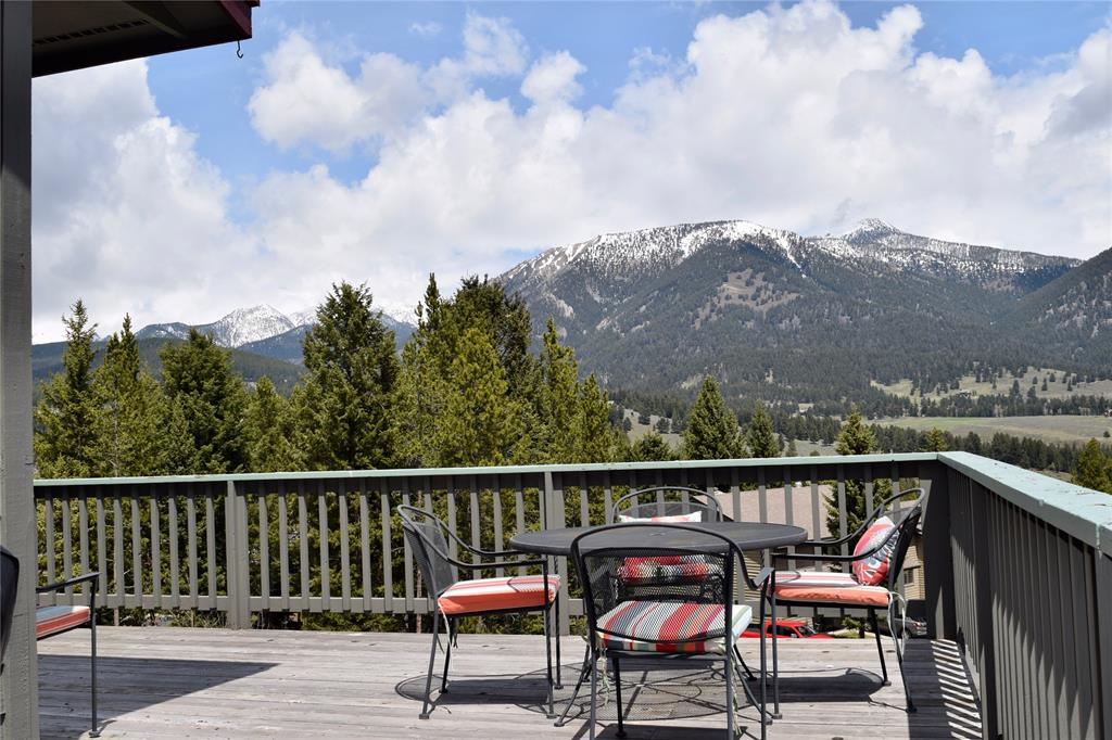Lowest price per square foot in ALL of Big Sky, tremendous value!  This spacious 2,788 sqft, 4 bedroom/ 3.5 bathroom condominium boasts gorgeous mountain views, an open kitchen and living room, additional living room/game room, private office, one car garage, and built in hot tub.  Tucked away in the Hidden Village neighborhood, this location provides easy access to Town Center and Big Sky Resort, all the while keeping the feeling of seclusion within the trees away from the hustle and bustle.  Just imagine relaxing and enjoying the amazing views from your own private oversized deck, and savoring delicious family meals in the fresh Montana air.