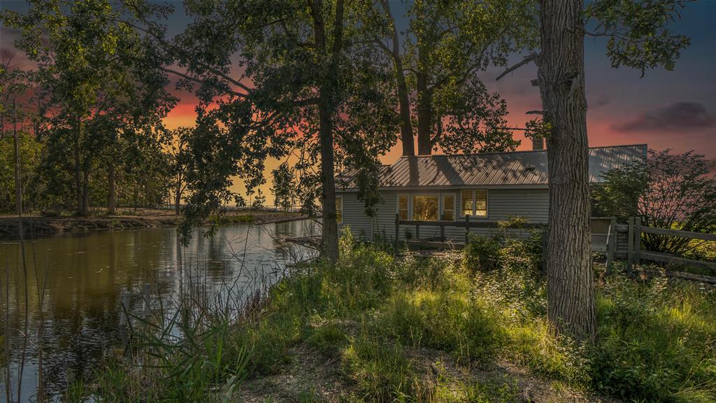 Hard to find 3-acres situated on  Saginaw Bay of Lake Huron. The property has amazing waterfront views, 279' of sandy lake frontage, a break wall and 200 feet of road frontage. The owners recently dredged a 10' deep channel along the south boundary of the property. All the protection you need from the lakefront with easy in/out access to some of the finest waters available in the State of Michigan. Saginaw Bay is known for its excellent Walleye and Perch fishing. The Fish Point Wildlife Refuge is located only 5 miles to the north along the shoreline of the Saginaw Bay. It's 4,075 acres in size and has some of the most sought-after water fowling and deer hunting available in the region. The parcel is improved with a 760 square foot one-bedroom cabin and has a 32X40 pole barn. The cabinand outbuilding are being sold 'as is' condition, no repairs. Located 100 miles from Detroit & 245 miles to Chicago. New windows and roof 10-12 years ago.