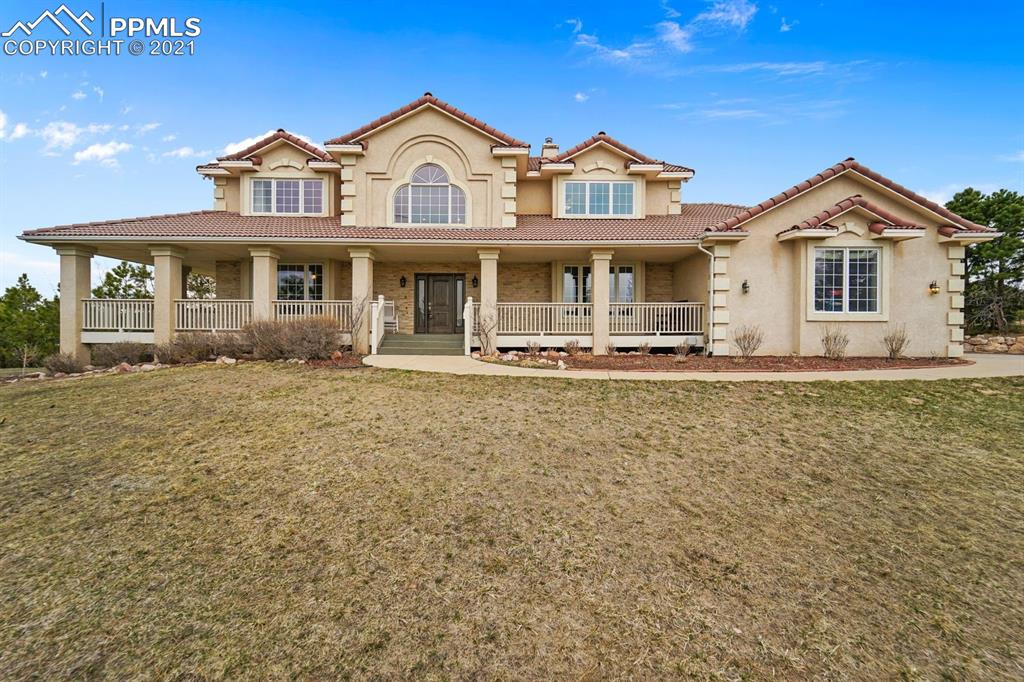 """This custom built home is a stunner! Poised on an elevated 2.54 acre lot with picturesque views of Pikes Peak and the Front Range, this home has everything you are looking for. The main level was completely remodeled in 2019 including hickory hardwood floors throughout and upstairs into the master bedroom. The kitchen which opens to the great room is the heart of the home and has all the bells and whistles anyone would love including lots of cabinet space. From the Soapstone counters to the Subzero refrigerator and 48"""" Wolf gas range, this kitchen will make anyone feel like a professional chef. The great room walks out onto an extensive wrap around deck that is perfect to entertain guests or enjoy summer nights watching mountain sunsets. The upper level was remodeled in late 2020 including new carpet everywhere. The master bedroom has a vaulted ceiling, fireplace, and massive walk-in closet. The 5 piece master bathroom boasts a new modern rustic look along with the hallway bathroom and the laundry room.  The walk out level basement offers two more bedrooms and TONS of extra space ideal for an additional living area and place to entertain family and friends. With the Pikes Peak views and 2.54 acres of privacy, this home is the epitome of Colorado living!!"""