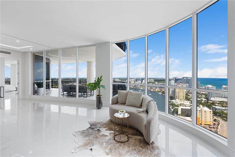 Rarely available & highly desirable NW corner Penthouse w/10' ceilings, floor-to-ceiling glass busting  spectacular 180°views of ocean,skyline,city &Intracoastal.This completely renovated 29th fl.residence offers 3200SF open floor plan w/2Beds+Den,3.5Baths residence.Master suites includes 2 separate his & hers Baths and 2 extra large walk-in closet.Incredible oversize 1200FT wraparound terrace is perfect for outdoor living & entertainment. Direct elevator access from garage into a private foyer of the residence. The best location in Fort Lauderdale just steps to the beach,water taxi,marina,shops & restaurants. 2 garage parking spaces,24hr. security,gym,steam & sauna room,heated pool,Jacuzzi,outdoor grill area,billiards,club room,library,bike storage,car wash & more.Pet friendly building!