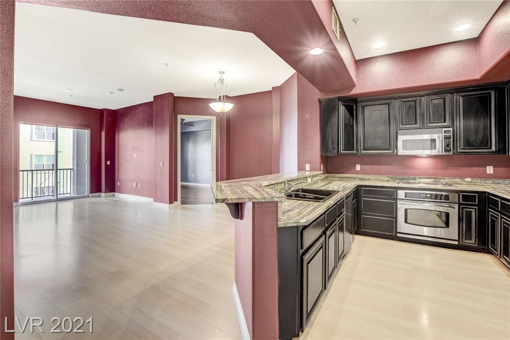 Beautiful Luxurious Open floor plan. Highly upgraded throughout the entire unit.  2 Bdrm, 2 Bath Condo. Guard Gated community with community pool, spa, fitness room, and trails. Walking distance to South point Casino, Las Vegas Outlet Mall, Town Square, Great shopping. Spacious kitchen, fireplace. Master with walk-in closet Sliding doors to Balcony. Hardwood Laminate Flooring