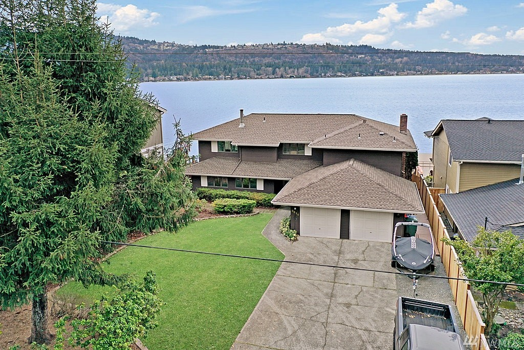 Live your dreams on coveted Lake Sammamish. Rare opportunity to renovate current home, start fresh and see your vision come to life. Watch eagles soar and exquisite sunsets on your 67 feet of prime waterfront w/ Westerly exposure. Large dock for all your waterfront toys. House is situated on a beautiful, level yard with ample parking. Quiet, private neighborhood down a dead-end lane.House has good bones and remodeling has begun. It just needs you! Endless opportunities for your waterfront dreams