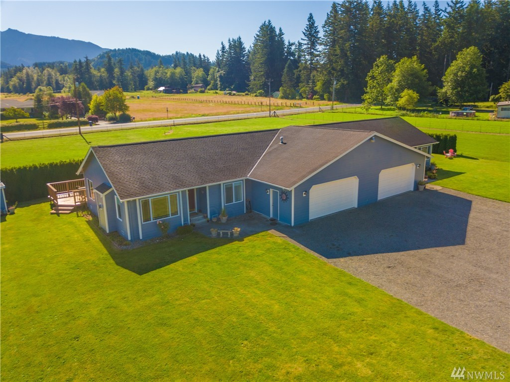 Owner occupant ALERT! 2,790 sq' SFR on 3.86 high and dry Enumclaw acres w/ attached accessory living unit (ALU). 1,395 SF 2 bed, 2 full bath per side plus huge 2 car garages (600 SF each). Owner's suites w/ vaulted ceilings, private 5 piece baths & walk in closets. Vaulted kitchen & living rooms. Gas FP inserts. Large decks off the eating areas. Foothill views. PBRS taxation for low taxes. Really just 2 awesome shy 1,400 SF homes glued together making the perfect multi-generational set up.