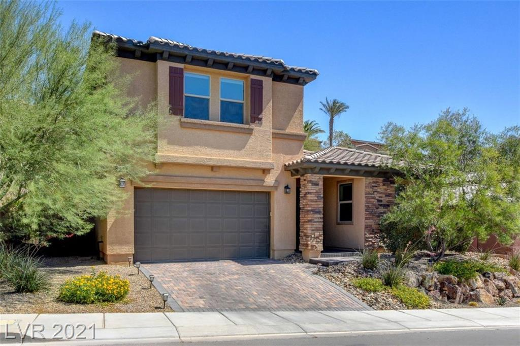 Stunning, immaculate pool home for the discerning buyer. This impressive home boasts a massive separate owners suite located on the main floor. Located in the highly sought after Lake Las Vegas gated community of Tremezzo. The upstairs is a vast loft that can be molded into a game room, office, theatre room, gym, etc. complete with a half bath. Downstairs you will find a wide open floor plan which separates the main bedroom from the other bedrooms. Large desirable lot with no properties behind. Name brand upgraded stainless steel appliances with convenient kitchen Island. Feel like you are on vacation all year round in your own private tropical inspired resort style backyard which is complete with an inviting salt water pool that boasts on-demand heating and color controlled lighting with fountains and jacuzzi. Lake Las Vegas Sports Club membership, valued at $10K, is included with purchase. Smart home compatible to control security, thermostat, pool, and cameras right from your phone!