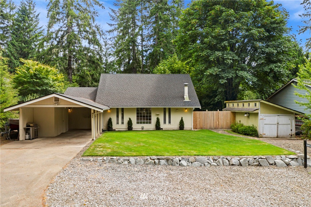 Welcome to this charming home in LakeLand Village. New cedar fence, Fresh interior paint, newer kitchen appliances and a vintage wood burning fireplace makes for cozy living. Plenty of space outside with an attached carport, a dettached single garage and graveled parking area out front. Situated on a spacious .257 acre yard with a mature fruit tree that supplies you with wonderful fresh peaches. Enjoy swimming, fishing, tennis, golfing & more with all of the amenities that LakeLand Village has to offer.
