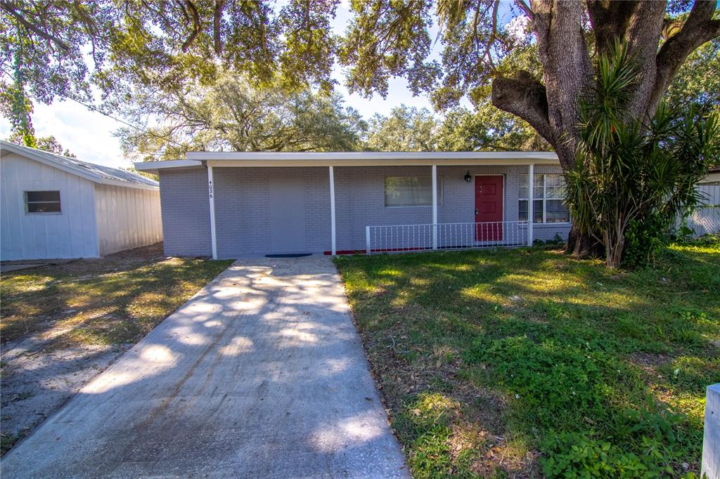 """Great opportunity for a separate entrance """"Private Home Office"""" with easy-reach-proximity for clients (close to I-75/MLK) & business-exposure on Falkenburg.   >>> 2 BUILDINGS: 1,462 TOTAL sq/ft (accurately measured) ~ 4/2 concrete block house (1,214 sq/ft) & separate metal building (248 sq/ft under A/C)...   >>> HOUSE: Family room, Kitchen/Dining combo, Master bedroom with full bathroom & walk-in-closet combo & access to private back covered Patio, 3 more Bedrooms sharing 2nd Bathroom.   >>> METAL BUILDING: large single room & full handicapped bathroom - perfect for a (i) Home/Office or (ii) mother-in-law suite or (iii) 5th bedroom (bring your own armoire) or (iv) rental income...   >>> Front & Back covered porches, Fenced-off level lot (bring your dogs), Laundry hook-up, Garden shed.   >>> No HOA/CDD.   >>> UPGRADES: New roof, Electrical & Septic drainage."""